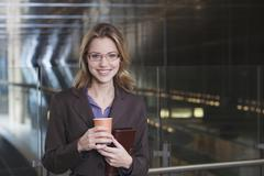 Germany, Bavaria, Munich, Business woman at subway station holding paper cup, Stock Photos