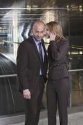 Germany, Bavaria, Munich, Business man and business woman at subway station - stock photo