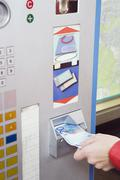 Germany, Bavaria, Munich, Person at ticket machine in subway station - stock photo