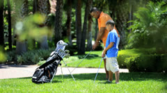 African American Father Enjoying Teaching Son Play Golf Stock Footage
