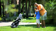 Stock Video Footage of Ethnic Father Teaching Son Game Golf