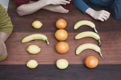 Raw fruits on wooden floor. Stock Photos