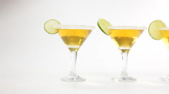 Martini cocktails with lime - stock footage