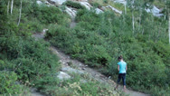 Stock Video Footage of Young girl walking up mountain trail HD 8612
