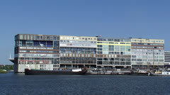 Cruise ship sailing at the IJ Amsterdam appears behind Silodam +  zoom out Stock Footage