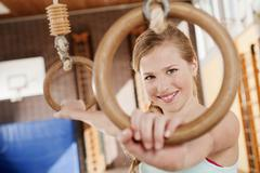 Germany, Emmering, Girl (12-13) holding flying rings and smiling, portrait - stock photo