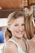 Germany, Emmering, Girl (12-13) holding flying rings and smiling, portrait Stock Photos