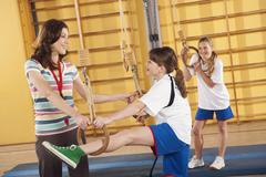 Stock Photo of Germany, Emmering, Woman training girls