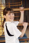 Germany, Emmering, Girl (12-13) smiling, portrait - stock photo