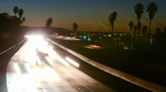 Medium angle Time lapse of morning rush hour traffic on the Ventura Freeway on Stock Footage