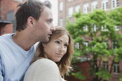 Germany, Couple relaxing on balcony, looking away Stock Photos