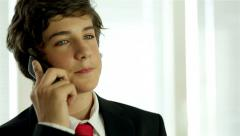 Young Business Kid At Home Making a Call Stock Footage