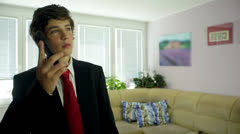 Business Boy On The Phone At Home Stock Footage