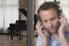 Stock Photo of Germany, Man listening music with piano in background