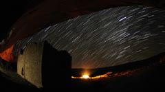 Time lapse star trail streaks over a Chacoan rock house in Gallo Wash in Chaco Stock Footage