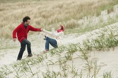 Germany, St.Peter-Ording, North Sea,Couple on beach dune - stock photo
