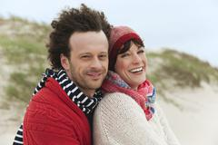 Germany, St.Peter-Ording, North Sea, Couple embracing on beach Stock Photos