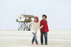 Stock Photo of Germany, St.Peter-Ording, North Sea, Couple walking on beach