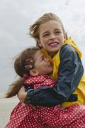 Germany, St. Peter-Ording, North Sea, Boy embracing girl (6-9) on beach Stock Photos