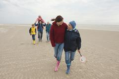 Germany, St. Peter-Ording, North Sea, Family  walking on beach Stock Photos