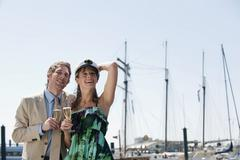 Stock Photo of Germany, Hamburg, Couple looking away and drinking champagne, smiling