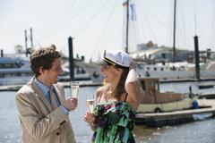 Stock Photo of Germany, Hamburg, Couple drinking champagne, smiling
