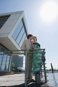 Stock Photo of Germany, Hamburg, Couple on floating home face to face, smiling