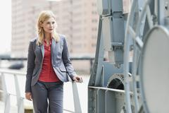 Germany, Hamburg, Businesswoman smiling at harbour Stock Photos