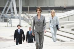 Stock Photo of Germany, Hamburg, Businesswoman with business people in background