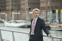 Stock Photo of Germany, Hamburg, Businessman looking away at harbour