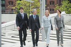 Germany, Hamburg, Business people walking together Stock Photos