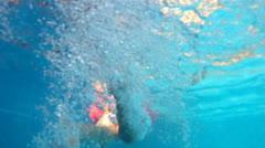SwimmingGirlUnderWaterAE Stock Footage