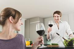 Germany, Hamburg, Man and woman with wine glass, smiling - stock photo