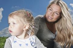 Germany, Cologne, Mother and daughter (2-3 Years) looking away Stock Photos