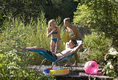 Austria, Salzburger Land, Teenagers (14-15) at garden pool - stock photo
