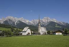 Austria, Land Salzburg, View of maria alm with mountain range in background Stock Photos