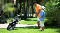 African American Boy Learning Game Golf Stock Footage