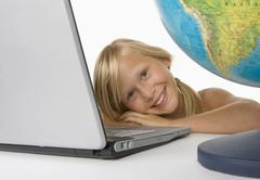 Girl (10-11) with laptop, smiling, portrait - stock photo