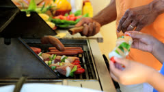 Hands Young African American Family Outdoor Barbeque - stock footage