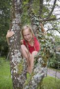Austria, Mondsee, Girl (12-13 Years) smiling, portrait - stock photo