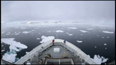 Bow point of view Time lapse of a ship breaking through sea ice in Stock Footage