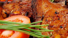 Meat on wooden plate : roast ribs on wood Stock Footage