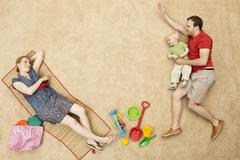 Germany, Family with toys at beach Stock Photos