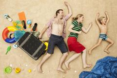 Stock Photo of Germany, Family with toys and baggage at beach