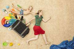 Stock Photo of Germany, Mother and son with toys and baggage at beach