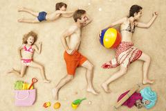 Germany, Artificial beach scene with family and beach toys Stock Photos