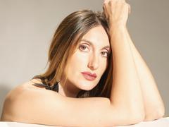 Spanish woman against grey background, portrait, close up Stock Photos