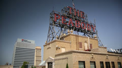 Memphis City Downtown - Peabody Hotel Roof Sign with First TN in Background Stock Footage