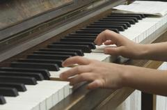 Germany, Bavaria, Girl using piano and making music Stock Photos