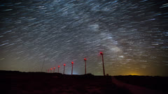 Wind turbine with milky way 7 Stock Footage